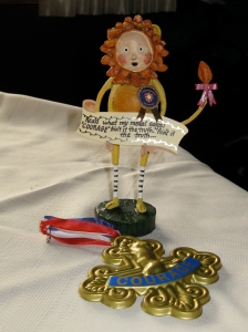 The Cowardly Lion statuette and the medal from my costume